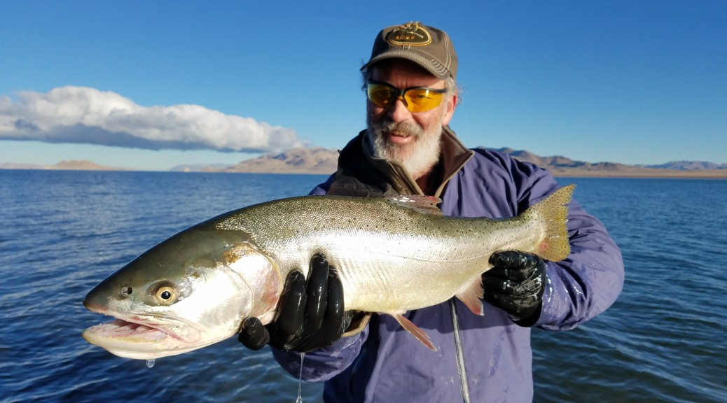 Dave McDonald of Sweet Lorraine's Bed and Breakfast holding a Pilot Peak Cutthroat